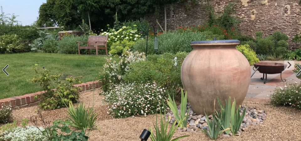 Beautiful traditional garden in Gloucestershire with large pot