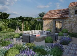 Outdoor seating area with purple flowers in the foreground in Provence France